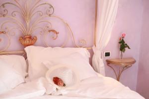 Camera Giulietta e Romeo letto e cuscini